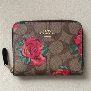 NWT Coach zip around wallet in signature canvas f